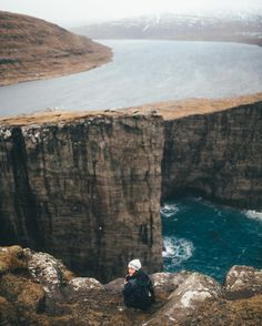 """Dylan Furst on Instagram: """"It was so windy that the raindrops literally pierced my eardrums. Lake Sørvágsvatn was unlike anything I've ever seen."""""""