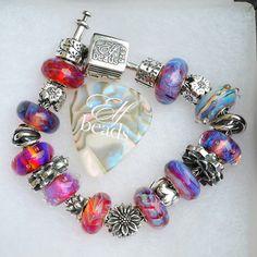 Finally got time to wash , polish and rearrange my bracelet to include Redbalifrog sunflower as the center piece .... elf beads bracelet is a bit bigger than troll walaupon aku mintak same size.... but best jugak size longgar ni....I can put 10 glass beads no sweat. ..#elfbeads #trollbeads #elleztrollbead #redbalifrog
