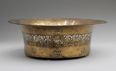 Basin with Zodiac signs and royal titles, Mamluk period (1250–1517), late 13th–early 14th century  Egypt or Syria  Brass; engraved and inlaid with silver and black compound