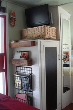 Magazine racks are a great way to utilize wall space! They can hold anything you want to keep handy such as: art supplies, lighters, first aid kits, books, flashlights, etc. Many attractive ones are available, and even double as a bedside table or art studio