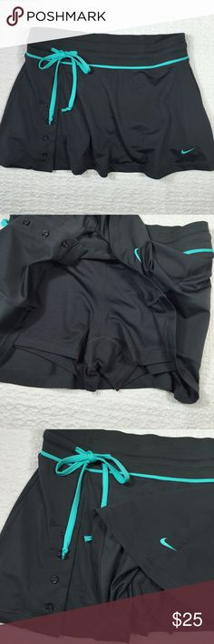 Nike Button Skort with Compression Shorts In excellent condition!   { FYI, I'm trying to clear some space in my closet, so I'm not interested in trading :) Thanks! } Nike Skirts