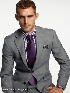Grey Vera wang suit style tux. Purple tie and a purple pocket