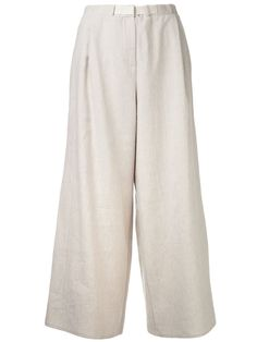 Natural linen blend imperial pants from Dusan featuring an elasticated waistband, a hook and zip fly, side seam pockets, a wide leg and a cropped length.