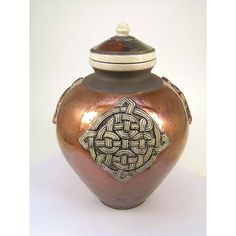 Raku Celtic burial urn holds the ashes of an adult and is a beautiful work of art that honors your loved one. Raku Pottery, Glazes For Pottery, Pottery Art, Guitar Wall Art, Burial Urns, Funeral Urns, Jar Design, Copper Dragon, Keepsake Urns