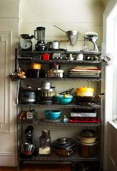 More industrial shelving... this may not fit with my vintage chic style, but its raw and interesting.