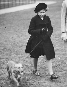 Princess Elizabeth takes her pet dog for a walk in Hyde Park, London, on Feb. 26. 1936. Then nearly ten years old. Her father was still Duke of York. Edward VIII was on the throne
