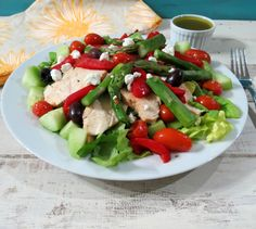 Warmed Greek Salad - A filling, healthy greek style salad made with roasted tomatoes, peppers and steamed asparagus and topped with a savory vinaigrette.