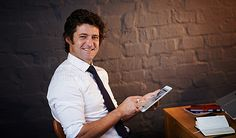 Shot of a businessman using a digital tablet in the office - stock photo #1314528