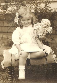 vintage photo of sweet little girl with a doll