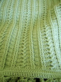 Beautiful combination of classic crochet stitches in this cozy blanket.
