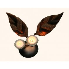 Made of Iron and Glass, it stand out for its eye catching combination of bronze color and glitter.  The two leaves add to its elegance. Ideal as a corner Décor.   Buy now at :- http://www.indikala.com/featured-products/wrought-iron-double-leaf-candle-stand.html #Buy #Decor #limited