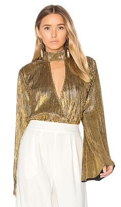 Shop for House of Harlow 1960 x REVOLVE Lynn Blouse in Gold at REVOLVE. Free 9321f003868