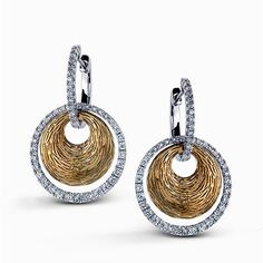 These eye-catching geometric-shaped contemporary two-tone earrings are complimented by .80 ctw of glistening round white diamonds in a remarkable white and yellow gold setting. Print Page