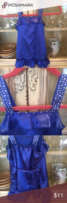 Cobalt blue sleeveless shirt size 8 Beautiful blue shirt with sequins/ bling. Tie in the back. 100% polyester size 8 Justice Shirts & Tops Camisoles