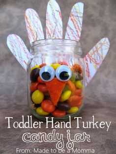 Toddler Hand Turkey Candy Jar- an adorable Thanksgiving craft, perfect for a centerpiece or just for snacking! @sugarbeecrafts
