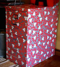 Learn how to decoupage a filing cabinet with wrapping paper - it's easy and the results are pretty amazing!