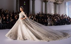 No matter how much of a diva you think you are, you will probably not get to the boss status Isabeli Fontana just achieved during the Ralph and Russo Spring 2016 couture show. The model closed out the label's latest showing in an epic bridal-esque gown, laden with ornate beading, arranged into gorgeous