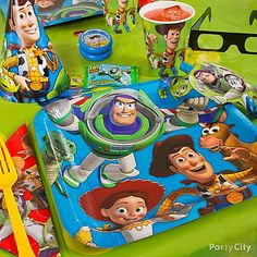 Decorating for Toy Story party  ...table cloth with most Woody, Buzz, Rex, and the other major characters  ....napkins with Woody, Buzz, etc  ....One of the many toy story center pieces   Toy Story Party Ideas - Toy Story Birthday Party Ideas - Party City