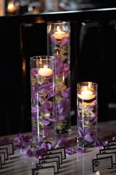 Water-Filled Candle Centerpieces: These floating wedding centerpieces are simple yet elegant -- and are perfect for the bride who wants to save money by doing a couple of DIY projects! Simply fill a couple of different sized vases with flowers and water and rest a flat-bottomed candle on top.