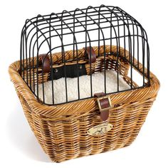 Cisco Pet Basket for your bike! Carry your pet safely wherever you ride with this pet carrier from Nantucket Bike Basket. Woven by artisans from high-quality rattan, it features a fleece pad and a wire lid to protect your pet. Easily and securely mount the basket to the handlebars of your bike. (Not suitable for German Shepherds, but a Chi or Yorkie will fit perfectly
