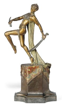 A FRENCH COLD-PAINTED AND GILT BRONZE MODEL OF A SWORD DANCER - CIRCA 1920/30