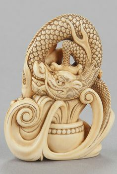 Ivory netsuke of dragon emerging in vapor cloud from alms vessel, Kyoto, late 18th century.