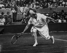Skirts got a little shorter by 1924, but they were still difficult to move in. Here, Mrs. George Wightman, captain of the United States women's Olympic tennis team, is shown in action on the courts at Wimbledon in England. Maybe her opponent's skirt was a little easier to move in -- Mrs. Whiteman was defeated by tennis ace Suzanne Lenglen that year.