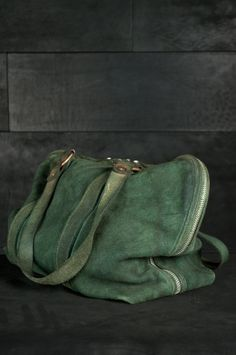 Guidi – Weekender Bag filled with A Coyuchi throw, ready for a seaside getaway for some storm watching.