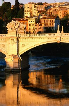 'Ponte Vittorio Emanuele II reflected in Tiber River at sunrise.' by Lonely Planet Images on artflakes.com as poster or art print $18.44