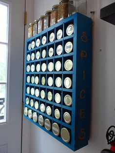 Spice rack - glass jars each in their own cubby, protected from sunlight!