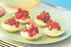 Creamy avocado canape cups with tomato salsa are a simple and budget-friendly way to feed the masses.