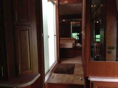 """2013 Used Dynamax Corp Trilogy 38RL Fifth Wheel in Illinois IL.Recreational Vehicle, rv, 2013 Dynamax Corp Trilogy 38RL, Triple Slide Trilogy Fifth Wheel, Rear Living Area w/2-Lounge Chairs, Ceiling Fan, Sofa/Free-Standing Table & Chairs Slide, Storage, Fireplace/40"""" TV/Pantry/4-Burner Range/Residential Refrigerator Slide, Kitchen Island w/Dbl. Kitchen Sink, Ceiling Fan, Pantry, Step Up To Bed/Bath, Shower, Private Toilet Area w/Lav., Lav., Dresser w/LCD TV Above, Washer/Dryer Prep, Walk-In…"""