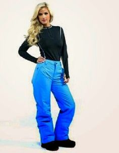 Shelley is Wearing Sky Blue Ski Pants.