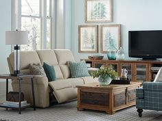 The Bedford Motion Sofa by Bassett Furniture is available in fabric or leather.