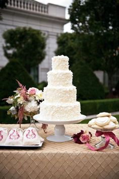 Four-tier coconut wedding cake. not everyone likes coconut... but it's not about them! ;)