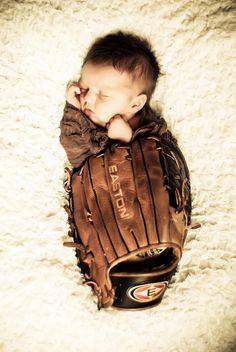 Newborn pictures in daddys baseball glove. @Natalie Riley