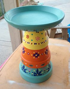 Bird bath made from terra cotta pots. Went for a Mexican pottery paint ...