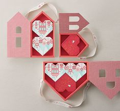 Valentine's Day Packaging & Visual Design for Starbucks Korea. Packaging: There are three sets of chocolate packaging, each outer containing one, two and three heart boxes, respectively. Each heart box contains 4 pieces of premium Belgian chocolates. Angular heart shape was inspired by a cross-stitched heart. Putting them in a house-shaped outer, with windows opening to show parts of heart boxes, it represents a home full of love. | HeyDesign.com