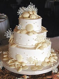 A sea shell adorned wedding cake. Perfect for a beach wedding. Followed by a traditional Clam and Lobster Bake, with steaks on the Barbie. Or a traditional Luau.