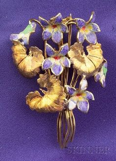 18kt Gold and Enamel Brooch, Tiffany & Co.  No diamonds, but it's Tiffany, and that is what counts!