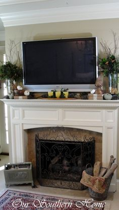 I need a mantle for our fireplace! And I love how this one is decorated for fall, even with a TV above it!