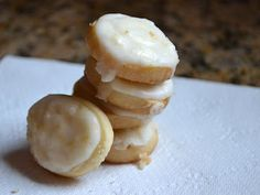 Lemon button cookies with tangy lemon frosting - they melt in your mouth!