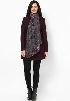 Update your winter accessory wardrobe by adding this red coloured scarf from Dorothy Perkins. Exhibiting a striking print, this scarf will become your favourite instantly. Furthermore, this 100% viscose scarf is soft to touch and comfortable to carry.