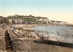 Victorian Colour Photo of Dover Castle, Seafront, and the White Cliffs, Kent, England, United Kingdom. Derived from United States Library of Congress photomechanical print dated circa 1890-1900. Promenade Pier (built 1893, demolished 1927) stood opposite Burlington Hotel above Waterloo Crescent on Marine Parade (left). Body of World War I heroine, Nurse Edith Cavell landed at pier in 1919. Pebble beach. History, Travel, Tourism, and Vacation. See: http://www.panoramio.com/photo/87954862