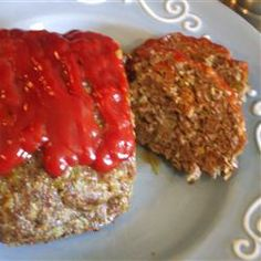 Ground beef meatloaf is made with egg, bread, and onions, then topped with a sweet and sour glaze, and baked.