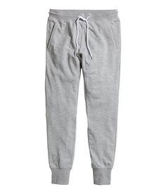 Soft gray sweatpants with decorative seams, elasticized drawstring waistband, and pockets.│ H&M Men