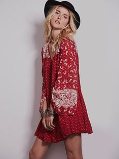 Shapeless boho printed mini dress with long bell sleeves and a split V-neck. Flares at hem. Lined.