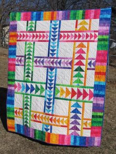 Rainbow quilt with flying geese. Pretty. Wandering Geese project on Craftsy.com