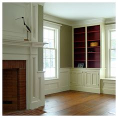 Although I hate when people paint wood, I like this & love the built-ins.  Would love to see the room in its original form. Vintage homes are the best!