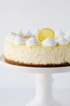 Crisp, refreshing Lemon Cheesecake...It's absolutely delicious with it's perfectly sweetened graham cracker crust and homemade lemon curd topping!
